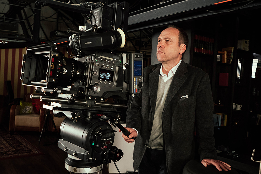 """British director Danny Kleinman at Sony Digital Motion Picture Centre Europe, Pinewood Studios. Kleinman recently directed Sony's """"Made For Bond"""" advert, which was shot Sony's F65 professional camera, interspersed with """"slow motion"""" surveillance that can be seen through the screen of the RX100 IV camera."""
